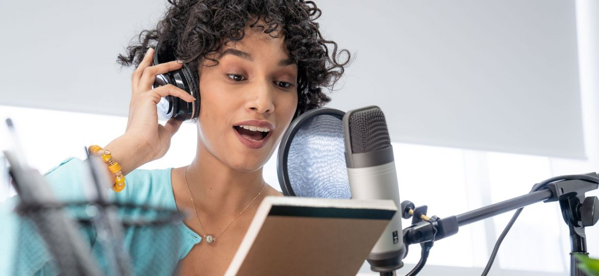 young-black-woman-podcast-reading-her-script