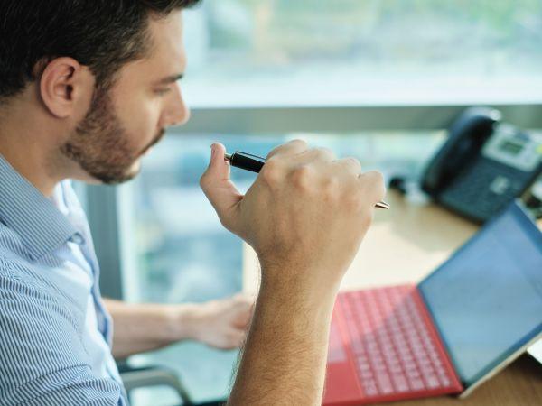 adult-business-man-clicking-pen
