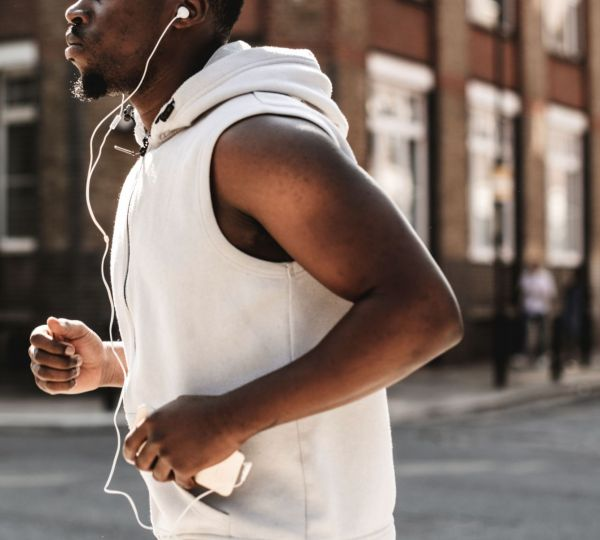 athletic-man-running-with-earphones