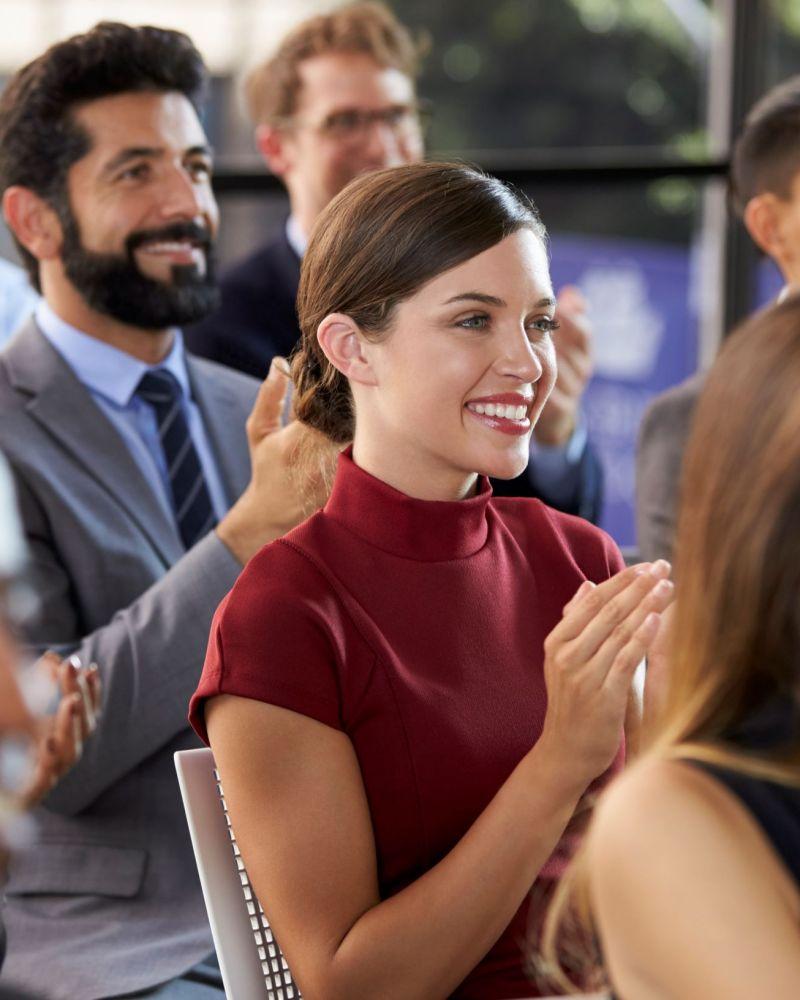 audience-applauding-at-a-business-seminar-close-up