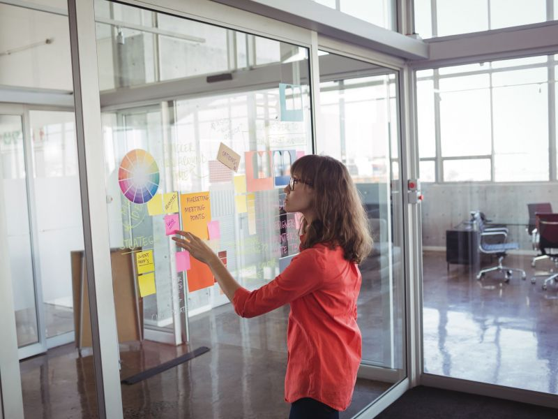 businesswoman-analyzing-strategies-in-creative