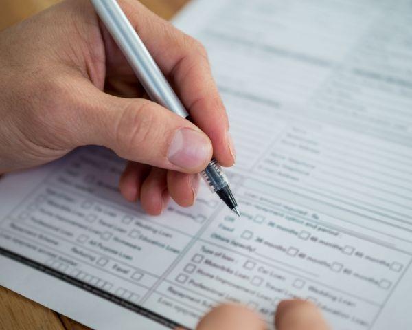 businesswoman-filling-form
