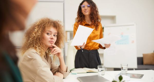 businesswomen-interacting-with-their-colleague