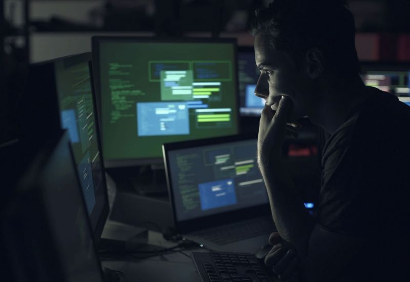 computer-developer-working-with-computers-at-night