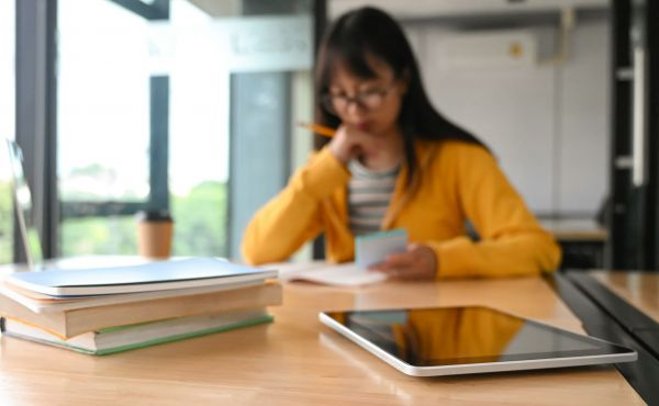 tablet-and-many-books-on-the-table